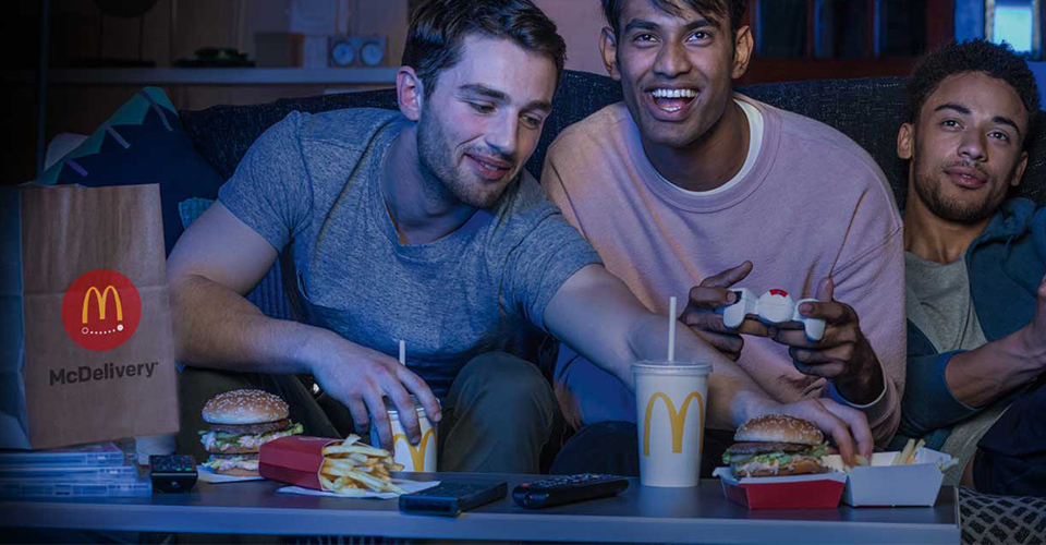 Friends Enjoying McDelivery Food at Home