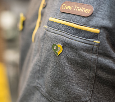 A crew trainer shirt with a badge