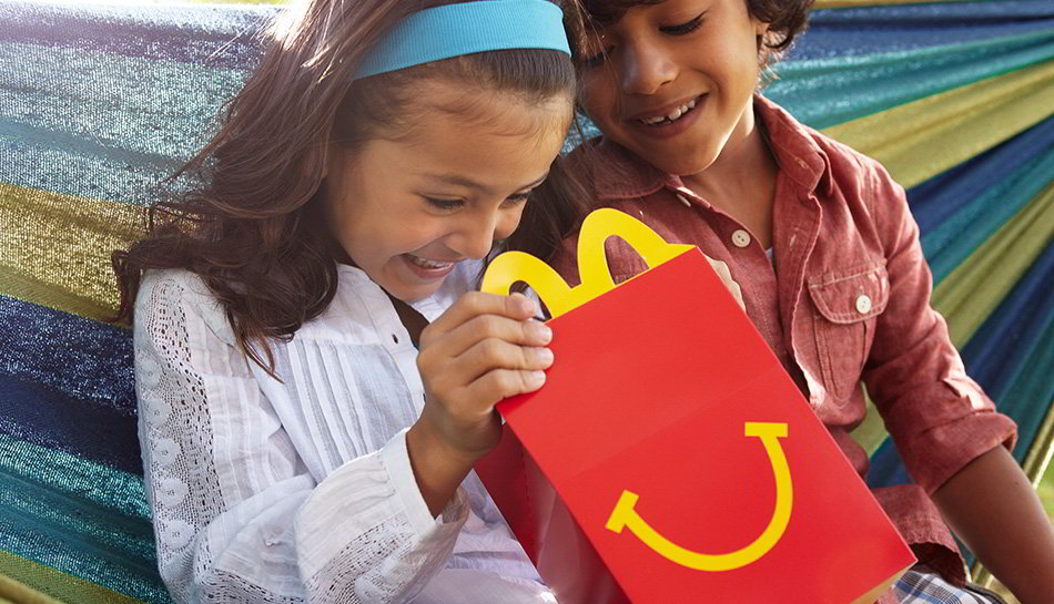 Children looking inside a McDonald's Happy Meal