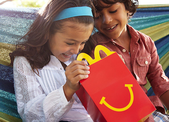 Children looking into a McDonald's Happy Meal