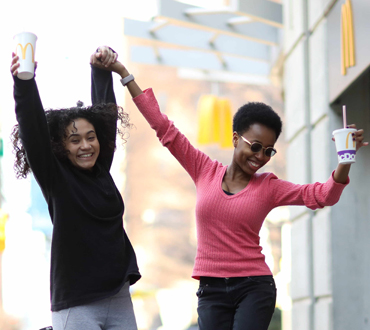 Two women jumping with joy
