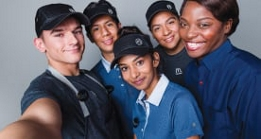 Five smiling McDonald's employees