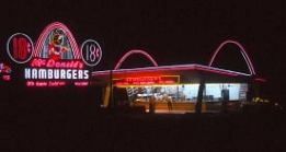 Vintage McDonald's restaurant and neon road sign